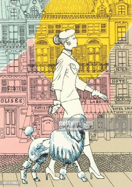 Woman walking in the city with poodle