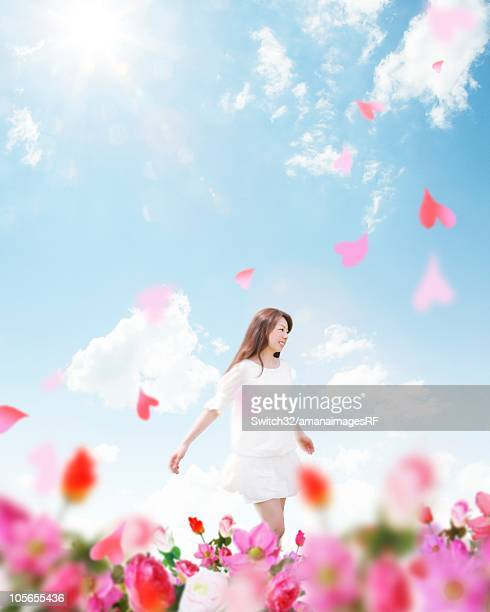 woman walking through flowers - only japanese stock illustrations, clip art, cartoons, & icons
