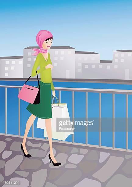 ilustraciones, imágenes clip art, dibujos animados e iconos de stock de woman walking with her shopping bags in a cityscape - mujeres de mediana edad