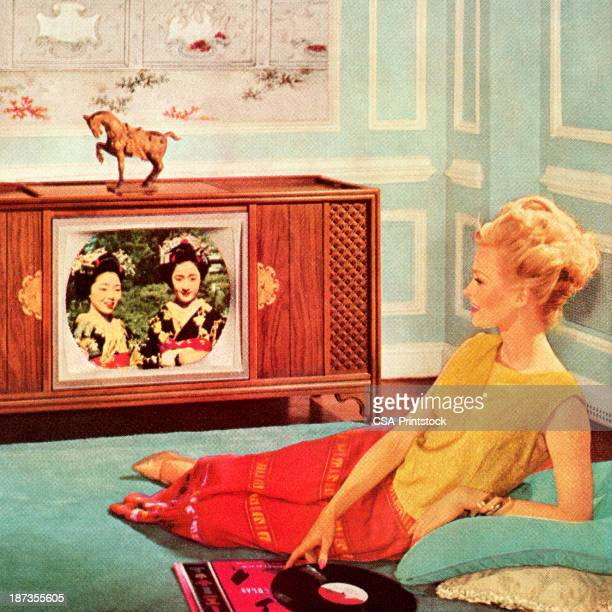 woman watching tv in blue room - television industry stock illustrations
