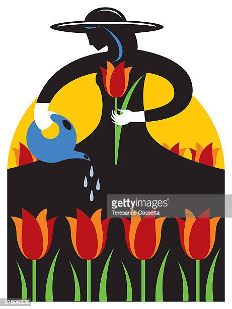 A woman watering flowers at a tulip festival