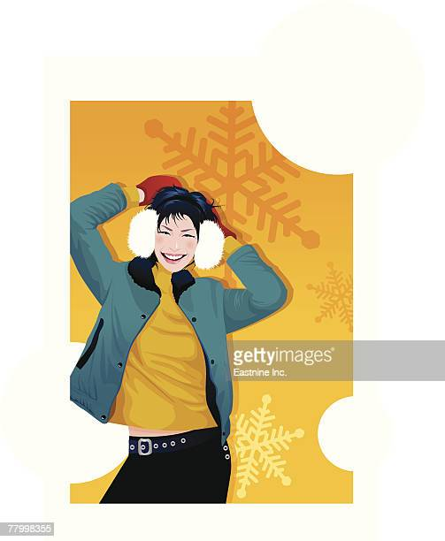 Woman wearing earmuffs and smiling