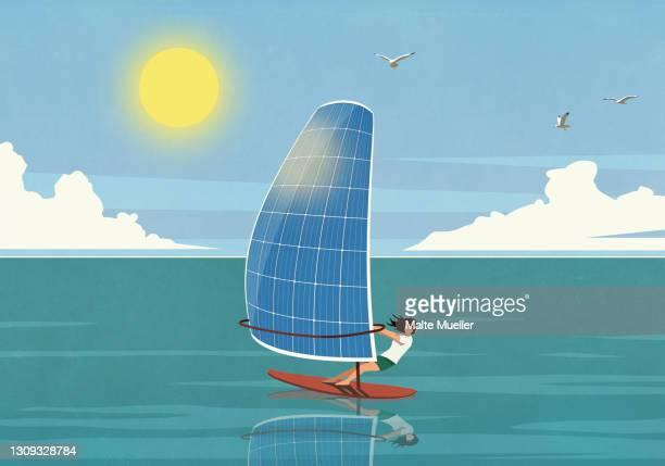 woman windsurfing with solar panel sail on sunny ocean - leisure activity stock illustrations