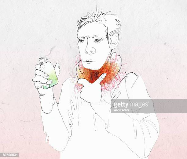 A woman with a sore throat holding medicine