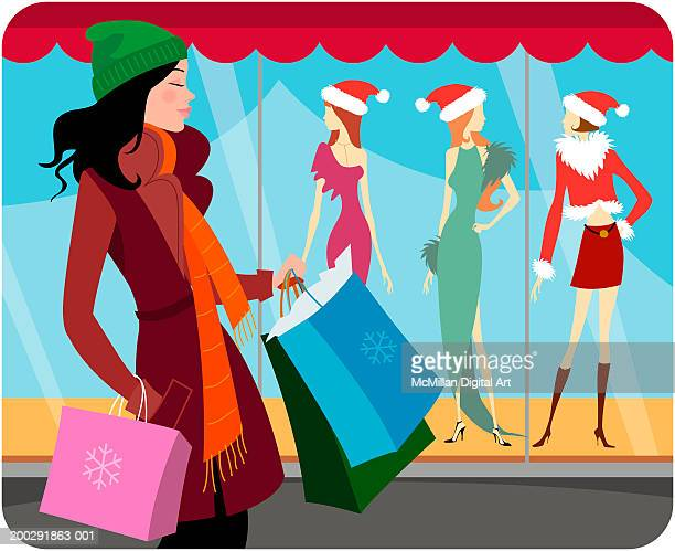 woman with shopping bags looking at christmas display in retail window - retail display stock illustrations, clip art, cartoons, & icons