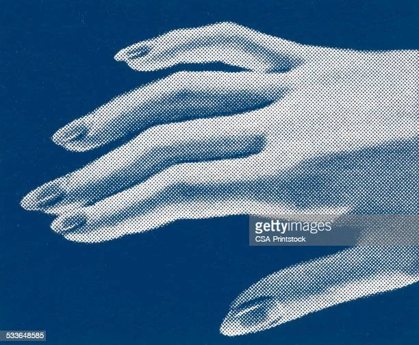 Woman's hand with painted fingernails