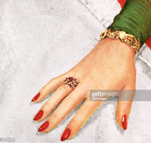 Woman's hand with red fingernails
