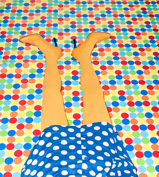 Woman's Yellow Legs on Polka Dot Floor