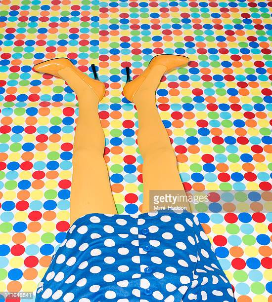 Woman's Yellow Legs on Polka Dot Floor