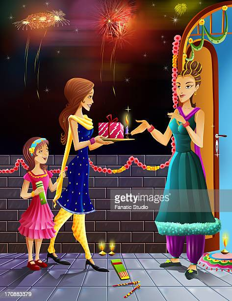 Women giving gift to her neighbour in the occasion of diwali