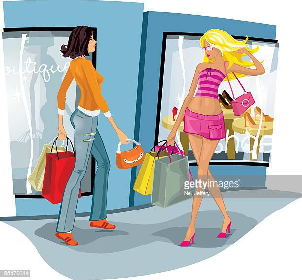 Women shopping with hands full of bags