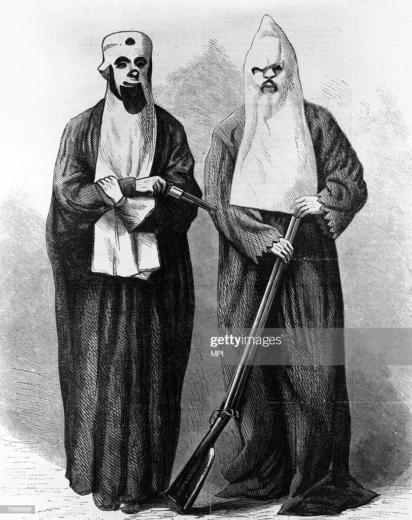 A wood engraving depicting two members of the Ku Klux Klan. The white sheet and hood were supposed to represent the ghosts of Confederate soldiers risen from the dead to seek revenge.