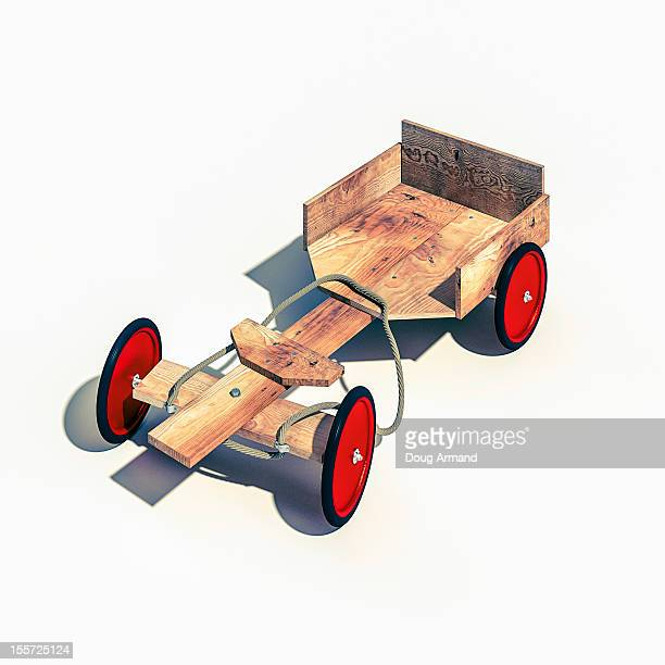 Wooden Go Cart with red wheels on white surface
