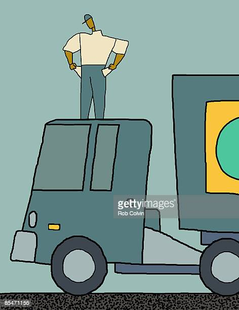 A worker standing on top of a truck showing his empty pockets