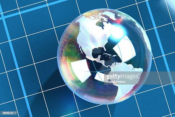 World globe made of glass placed on a white grid