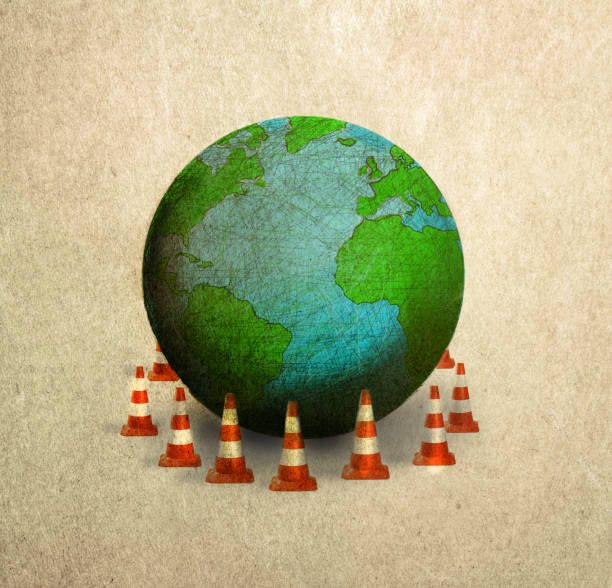world surrounded by traffic cones