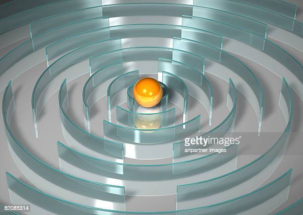 yellow ball in centre of maze - toy stock illustrations