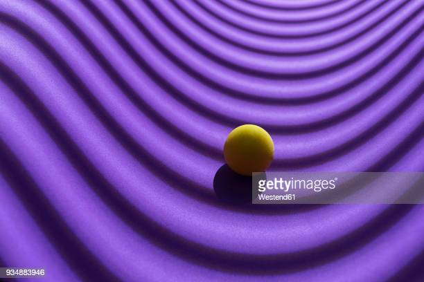 yellow sphere over a geometric purple background, 3d rendering - purple background stock illustrations