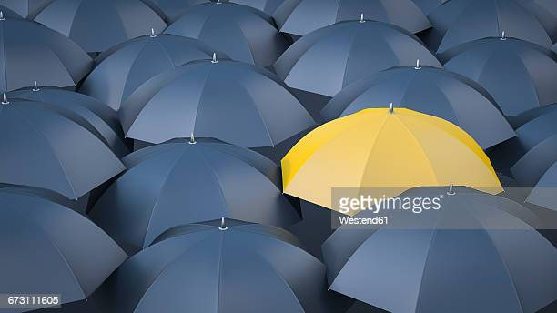 yellow umbrella in between many black umbrellas - joy stock illustrations
