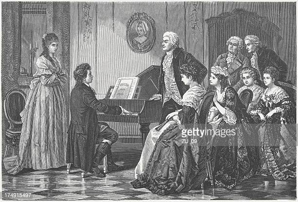 young beethoven playing before mozart - wolfgang amadeus mozart stock illustrations