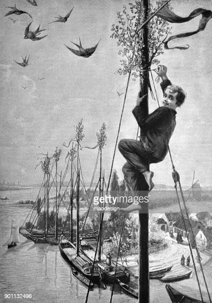 young boy is climbing on the mast of the sailing boat. he tries to hang a may wreath on it - 1896 - 1896 stock illustrations, clip art, cartoons, & icons