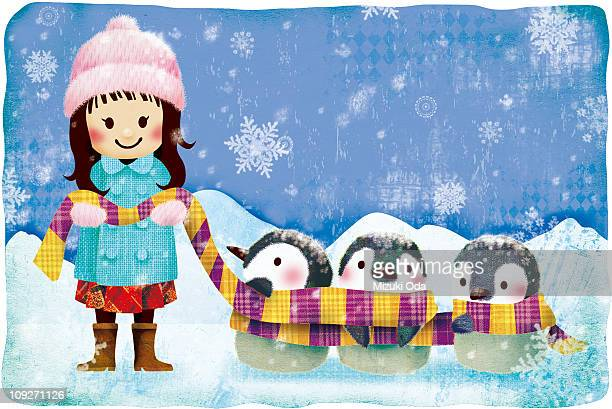 A young girl and three penguins