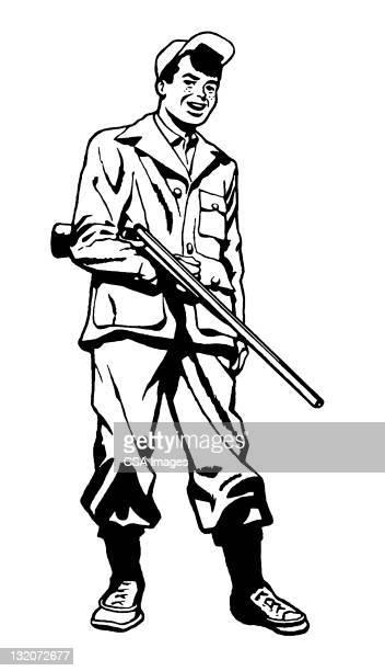 Young Hunter Holding Gun