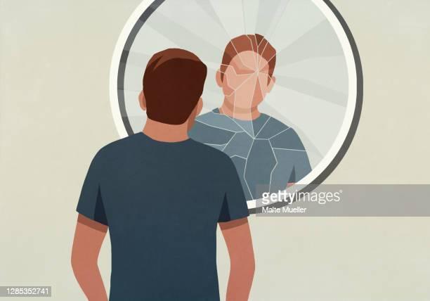 young man looking into cracked mirror - öffentlicher auftritt stock-grafiken, -clipart, -cartoons und -symbole