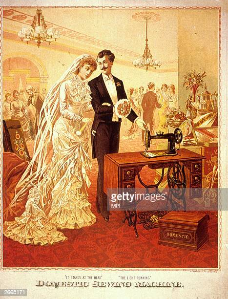 A young man showing his wife a domestic sewing machine