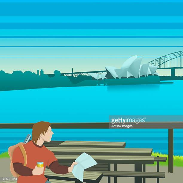 young man sitting on a bench and holding a map, sydney opera house, sydney, australia - sydney opera house stock illustrations
