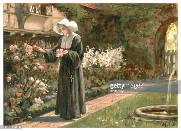 Young nun gathering flowers in a summer garden