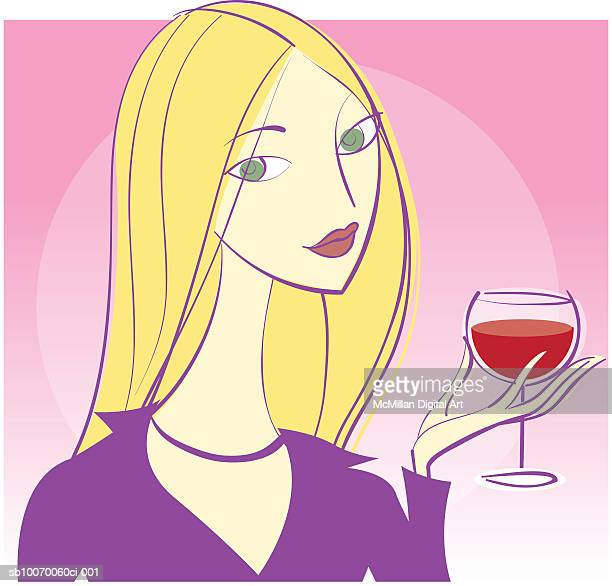 Young woman holding glass of red wine
