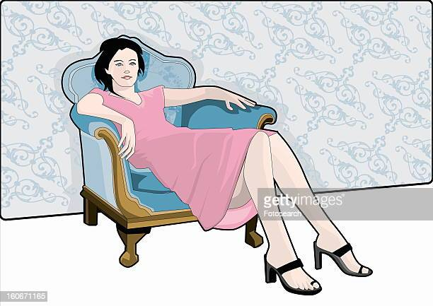 Young woman sitting on armchair