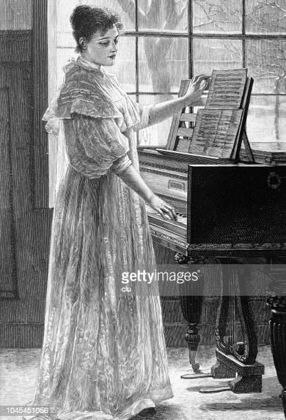 illustrations, cliparts, dessins animés et icônes de jeune femme debout au piano - pupitre à musique