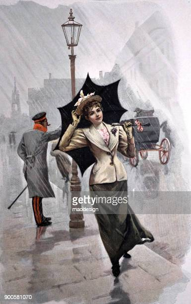 Young woman walks on the street with umbrella in the rain - 1896