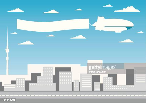 Zeppelin flying over the town