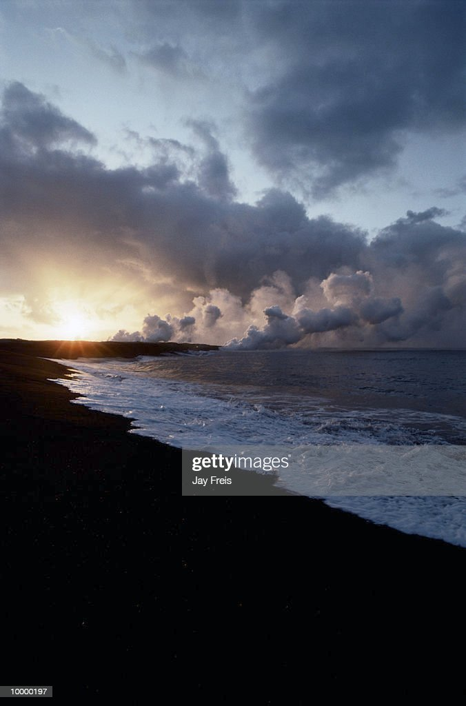 OCEAN TIDE ON BLACK SAND & LAVA FIELD IN HAWAII : Stock Photo