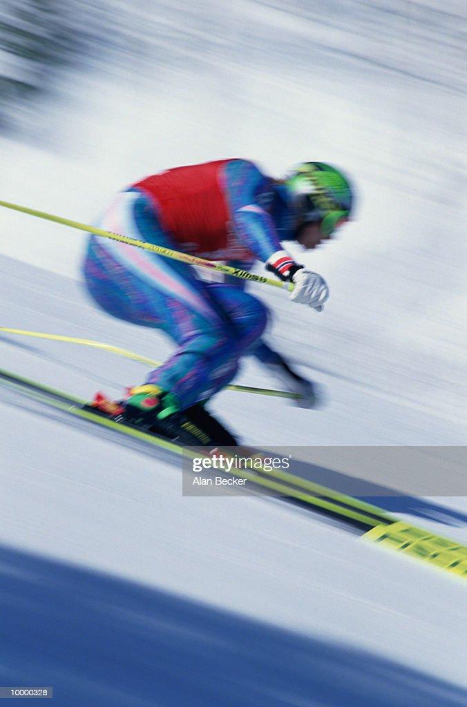 DOWNHILL SKI RACER IN BLUR : Stock Photo