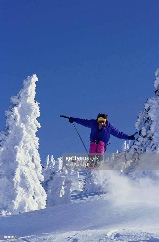 SKIER IN MIDAIR : Stock Photo