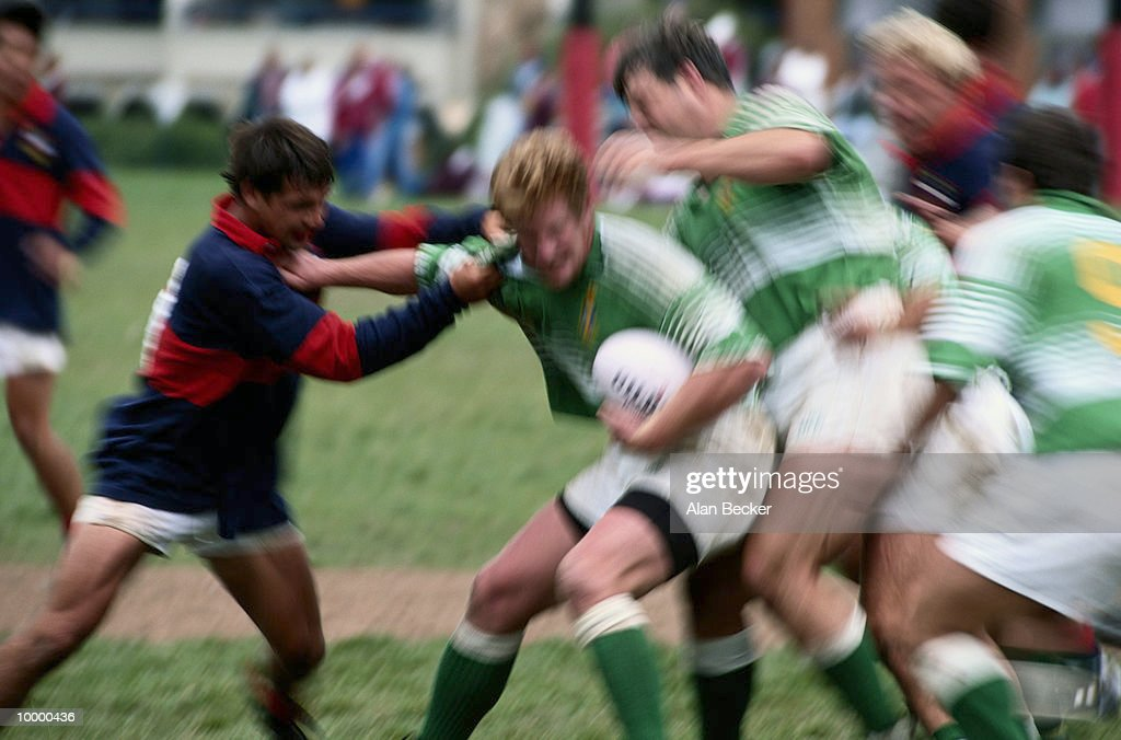 MEN PLAYING RUGBY IN BLUR EFFECT : Stock Photo