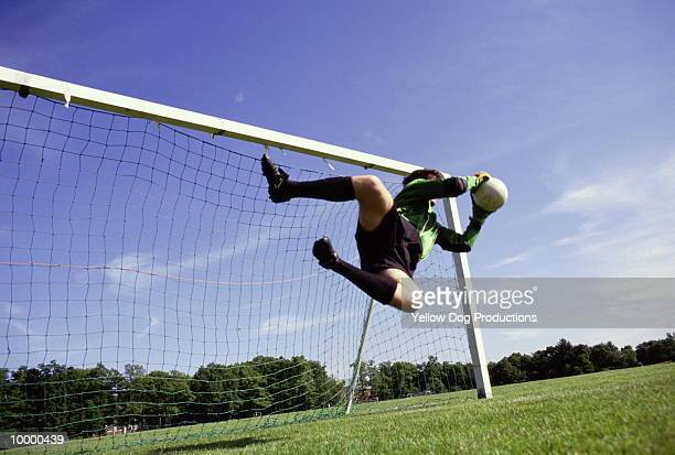 goalie in midair with soccer ball - goalkeeper stock pictures, royalty-free photos & images