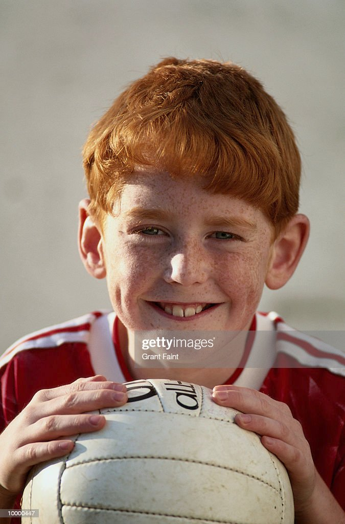 REDHEADED BOY WITH SOCCER BALL : Stock Photo
