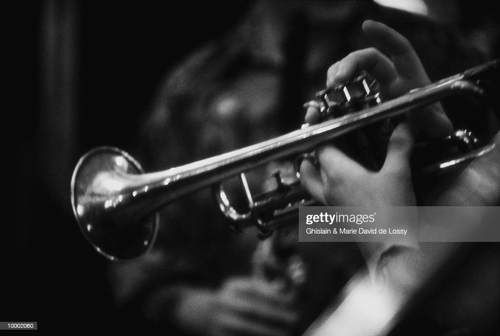 MUSICIAN WITH TRUMPET IN DETAIL AND BLACK AND WHITE : Stock Photo