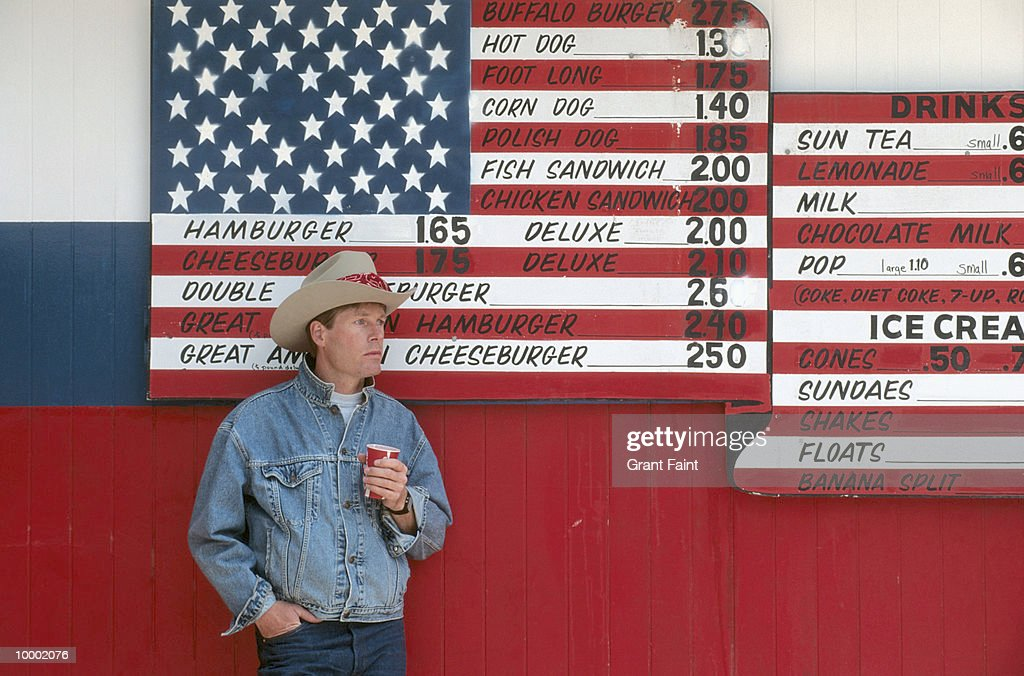 MAN IN HAT BY UNITED STATES FLAG MENU IN NORTH DAKOTA : Stock Photo