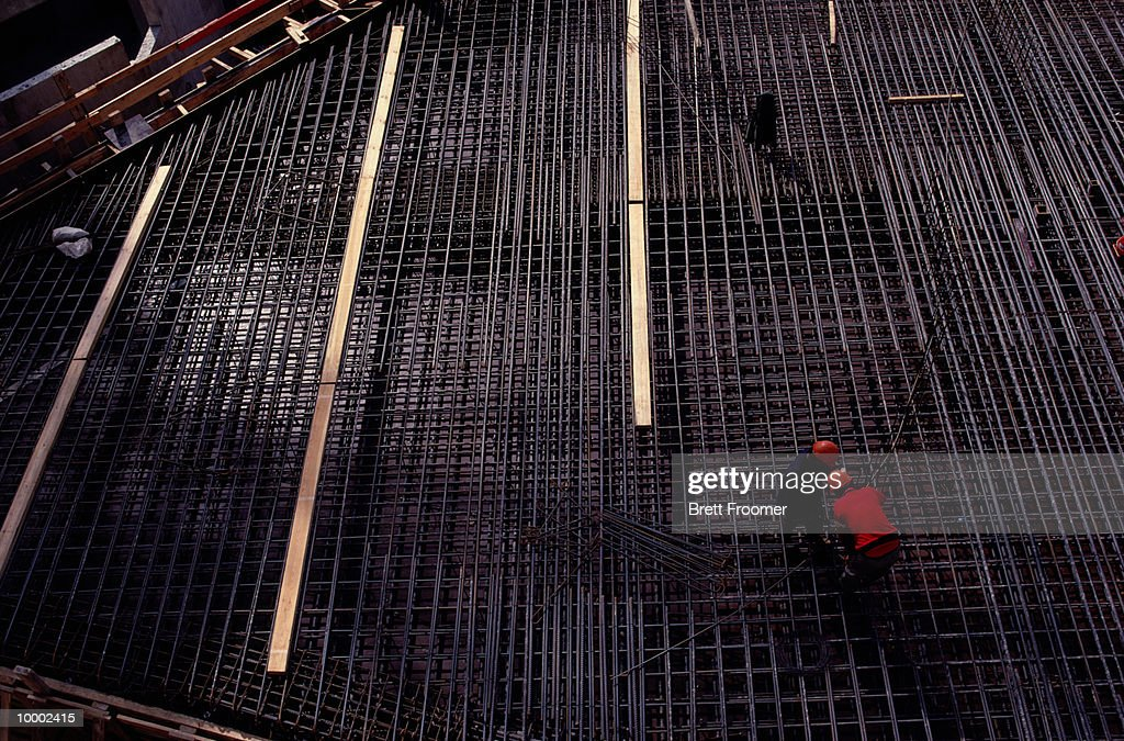 CONSTRUCTION WORKERS ON STEEL REBAR GRID : Stock Photo