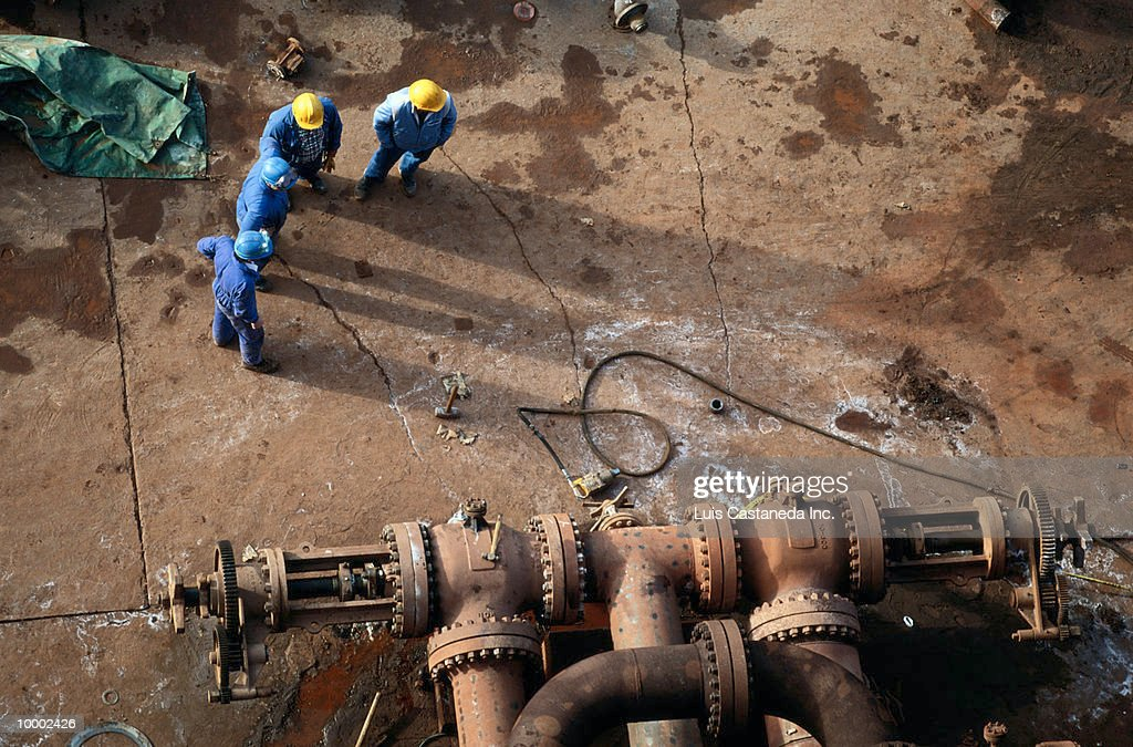 WORKERS AT ALUMINUM PROCESSING PLANT : Stock Photo