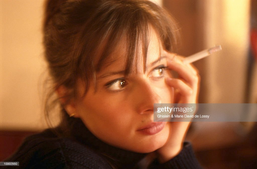 WOMAN HOLDING CIGARETTE : Stock Photo