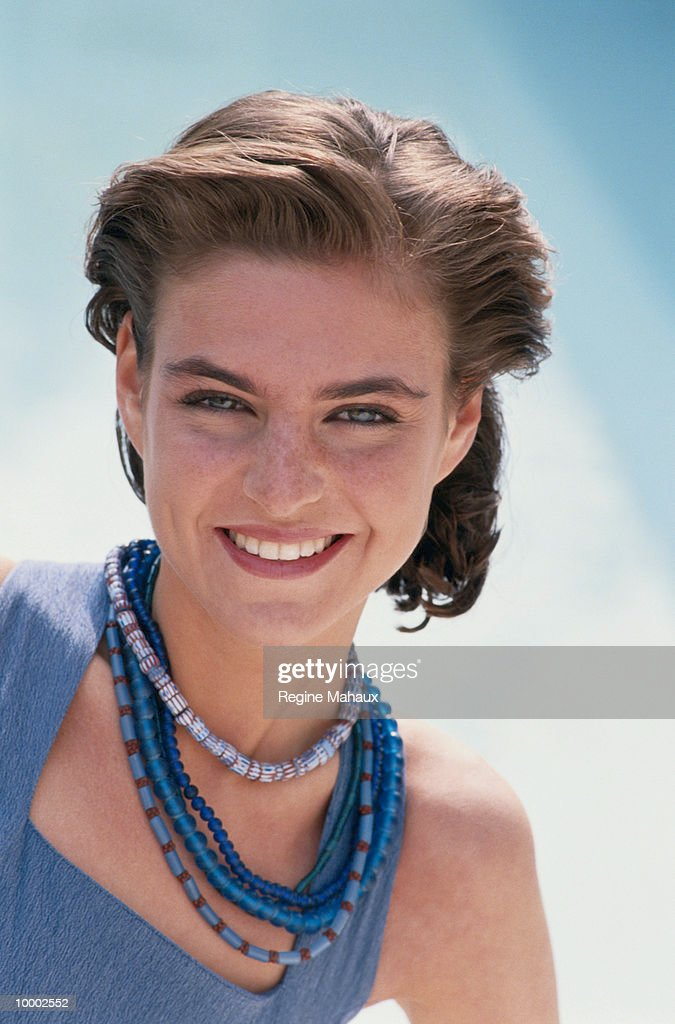 YOUNG WOMAN IN BLUE BEADS : Stock Photo