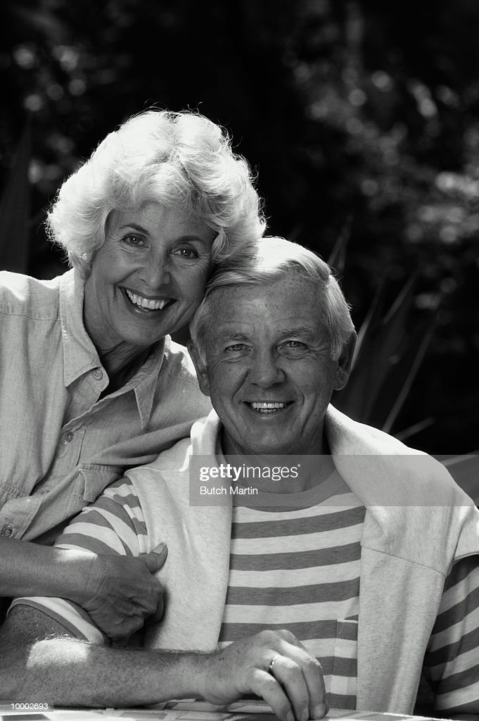 MATURE COUPLE OUTDOORS IN BLACK AND WHITE : Stock Photo