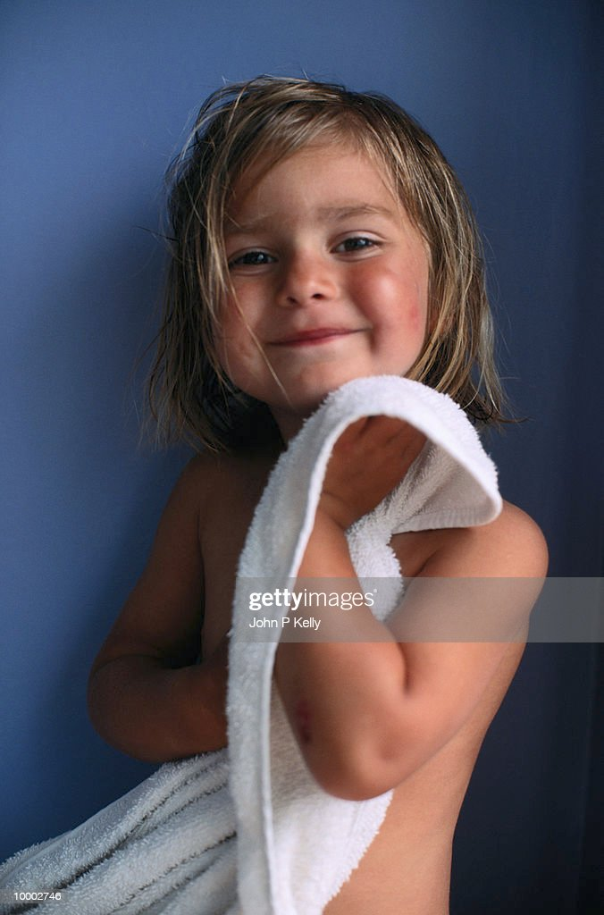GIRL (3-5) DRYING OFF WITH WHITE TOWEL : Stock Photo